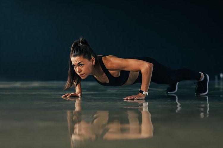 Full length of woman exercising on floor