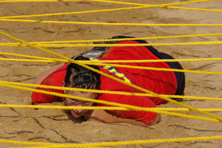 Close-up Colorful Day Detail Exercise Full Frame Multi Colored Obstacle Course Orange Color Outdoors Ropes Sand Tired Tired Eyes  Yellow