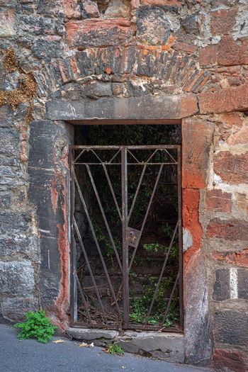 Architecture Built Structure Old No People Wall - Building Feature Day Wall Entrance Closed Door Brick Wall Abandoned Building Exterior History Weathered Brick Wood - Material The Past Outdoors Solid Stone Wall Wheel Marburg Innenstadt Morbide Details Eisentor