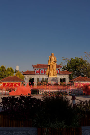 View of temple building against clear sky
