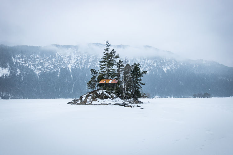 Frozen Eibsee in Winter Eibsee Frozen Lake Zugspitze Adventure Beauty In Nature Cabin Cold Temperature Day Fog Frozen Frozen Nature Landscape Mountain Mountain Range Nature No People Outdoors Scenics Secret Cabin On The Cliff, Photo Window, Snow Tranquil Scene Tranquility Travel Destinations Tree Winter