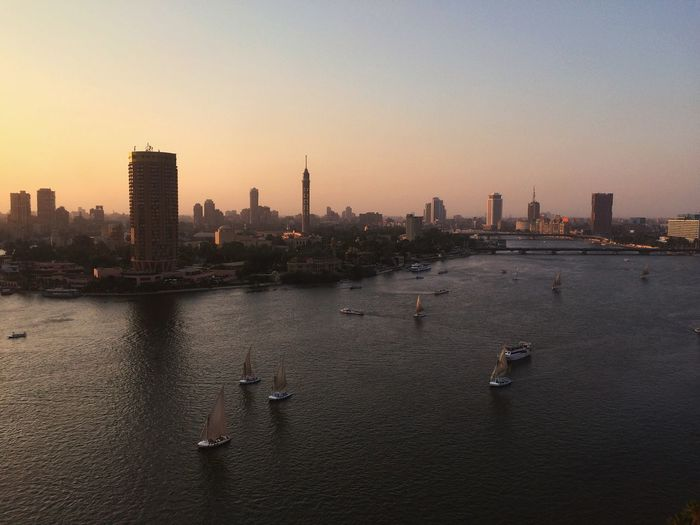 Nile River Egypt 🇪🇬 Nile Egypt IPhoneography Architecture Built Structure Building Exterior Sky City Water Building Office Building Exterior Urban Skyline Skyscraper Sunset Nature Landscape Modern Cityscape No People River City Life Outdoors