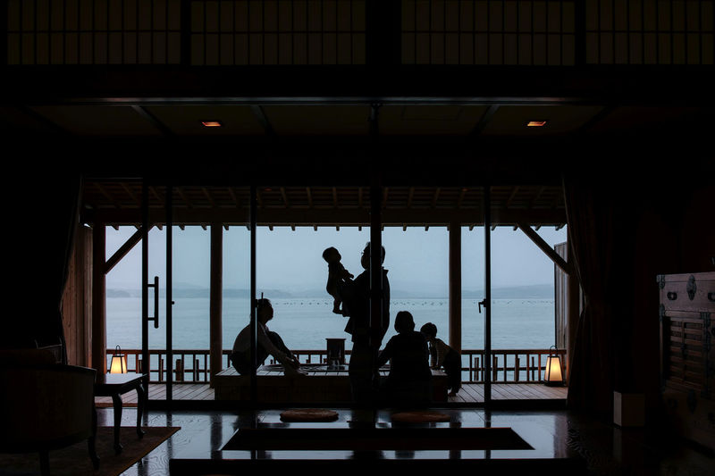 Silhouette people sitting in bus