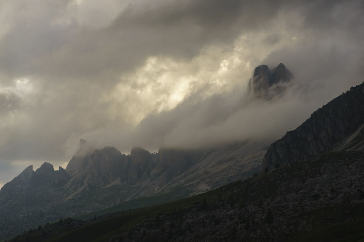 Colle Santa Lucia Dolomites Passo Giau Alps Clouds Italy Mountain Sunset Dramatic Sky Sunshine Mountain Range San Vito Di Cadore Travel Destinations Panoramic Mountain Peak Sky Silhouette Scenics Outdoors No People Nature Landscape Day Storm Valley Lost In The Landscape