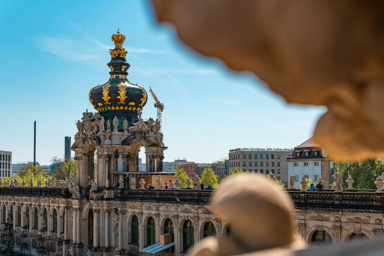 Dresden, Gemany Summertime and Blue Sky Adult Architecture Building Building Exterior Built Structure City Day Focus On Background History Lifestyles Men Nature Outdoors People Real People Sky The Past Tourism Travel Travel Destinations Travel, Dresden, Building, Germany, Saxony, City, Europe, Landmark, Architecture, Square, Cathedral, Old, Church, Tourism, Panorama, European, Semperoper, Summer, Palace, Frauenkirche, Historical, German, Famous, Urban, Town, Hofkirche, Blue, Trinity, Lan