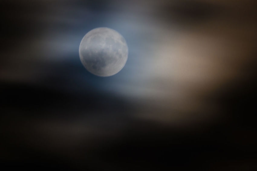 Full moon between the clouds EyeEmNewHere Moon Shots Beauty In Nature Cloud - Sky Full Moon Moon Moonlight Nature Night No People Planetary Moon Tranquil Scene Tranquility