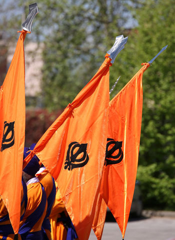 many orange sikh flags with khanda symbol during a religiuous procession Baisakhi Indian Ocean Sikhi Group Khanda Khanda Sikh Nagar Nagar Kirtan Nagarkirtan  No People Orange Orange Color Outdoors Punjabi Religion Religion Architecture Religious  Rite Sikh Sikh Flag Sikh Theme Sikhism Sikhlife Sikhs Symbol