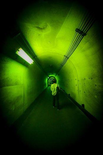 立ち止まった。 Illuminated One Person Full Length Indoors  Standing Real People Green Color Lighting Equipment Architecture Tunnel Light Walking Light - Natural Phenomenon