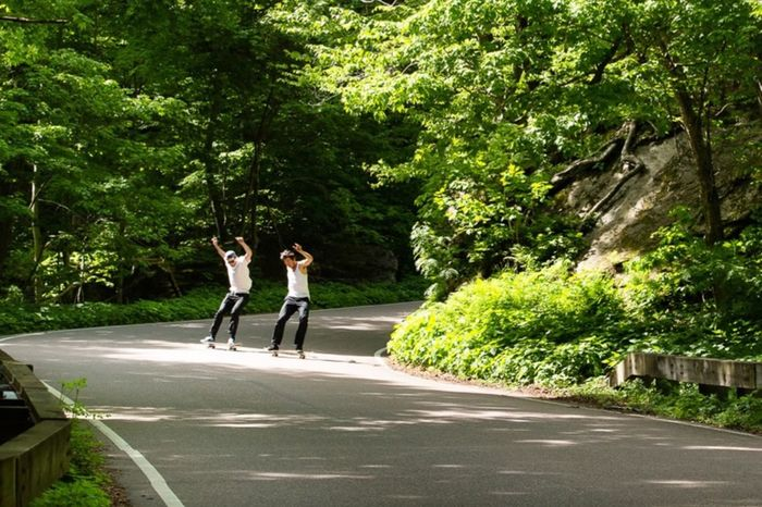 TwentySomething Power sliding down the mountain road in Vermont > Kyle and Stefan making the most of a Summer day on their Skateboards , why not?!