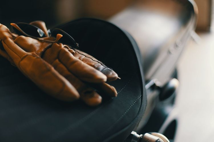 Close-up of glove on motorcycle