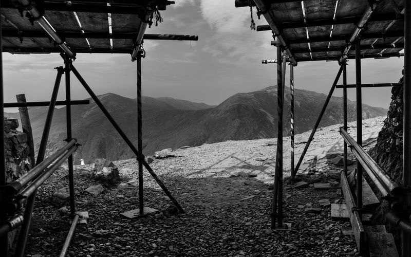 Building mountains... Construction Construction Industry Black And White Photography Black And White The Way Forward Blackandwhite Scaffolding Mountain Sky Landscape Scenics Mountain Range Tranquil Scene Remote Tranquility Calm Rock Formation