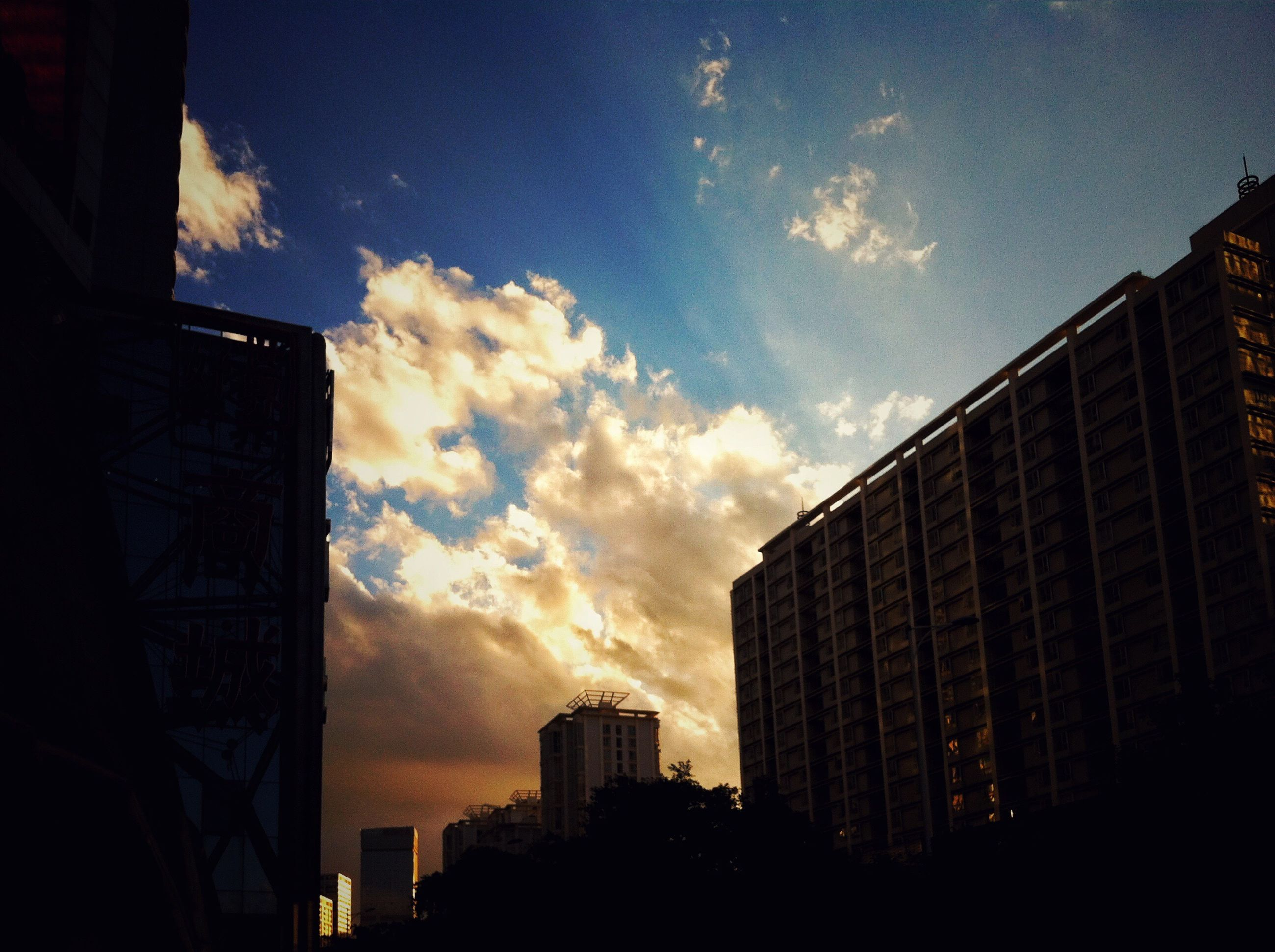 building exterior, architecture, built structure, sky, city, silhouette, sunset, cloud - sky, building, low angle view, residential building, skyscraper, cloud, office building, residential structure, dusk, cloudy, city life, outdoors, modern