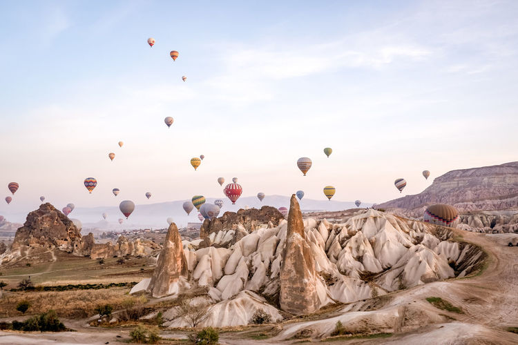 View of hot air balloons flying over rocks