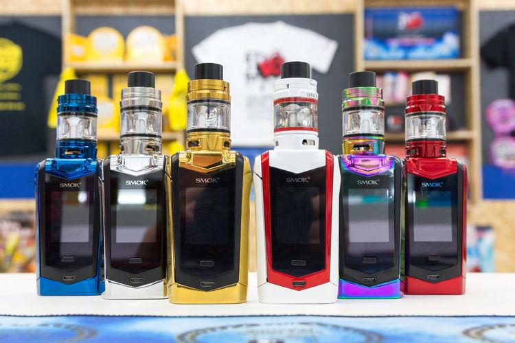 The Smok Species vape kit Container Bottle Choice Variation Indoors  No People Glass - Material Close-up Transparent Side By Side Multi Colored In A Row Arrangement Focus On Foreground Collection Food And Drink Selective Focus Still Life Technology Reflection SMOK Brand Vape Species Tfv Mini V2 Vape Shop