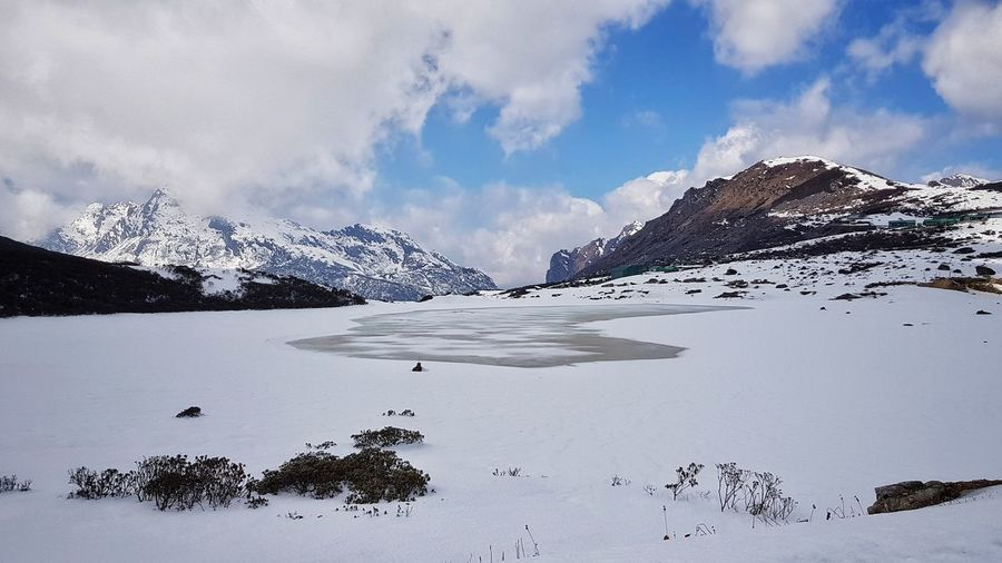 Frozen Lake at Bumla Pass Travel Photography Arunachal Pradesh EyeEm Best Shots Tawang Perspective Snow Bumla Pass Travel Frozen Lake Snow Snowing Landscape Photography Landscape Sky Cloud - Sky India Buddhist Lake