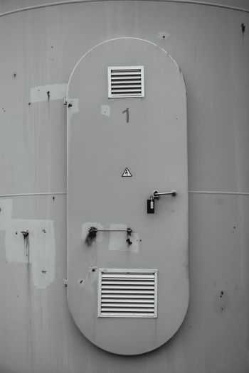 Alternative Energy Black And White Blackandwhite Built Structure Close-up Closed Door Energy Entrance Industrial Monochromatic Monochrome No People White Windmill Work Environment