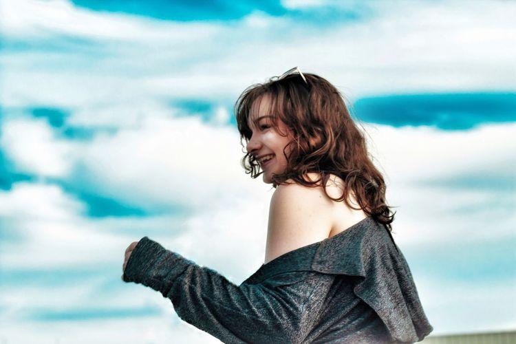 Portrait of woman against sky