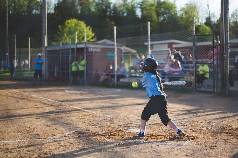Sport Full Length Playing Lifestyles Real People Competitive Sport Childhood Competition Boys Ball Focus On Foreground Leisure Activity Motion Healthy Lifestyle One Person Outdoors Court Day Sports Clothing Basketball - Sport Softball Softball Game