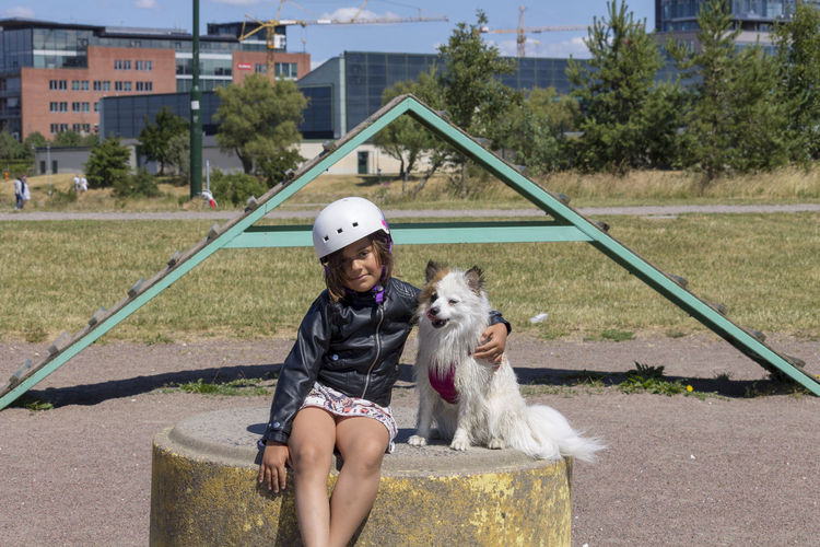 Girl with dog Canine Dog Domestic Animals Looking At Camera One Person Papillon Pets Spitz