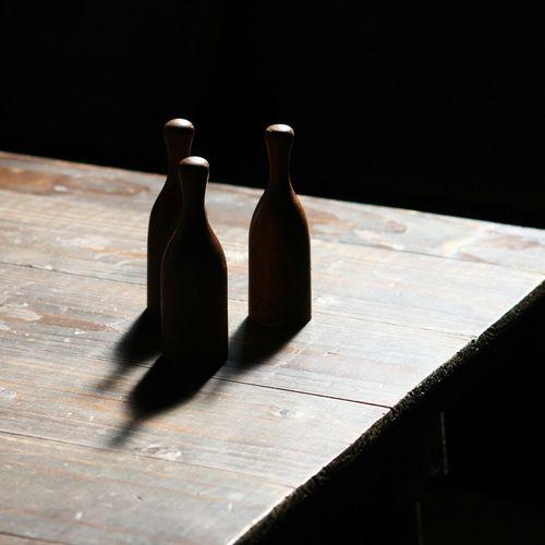 Bottles on wooden table