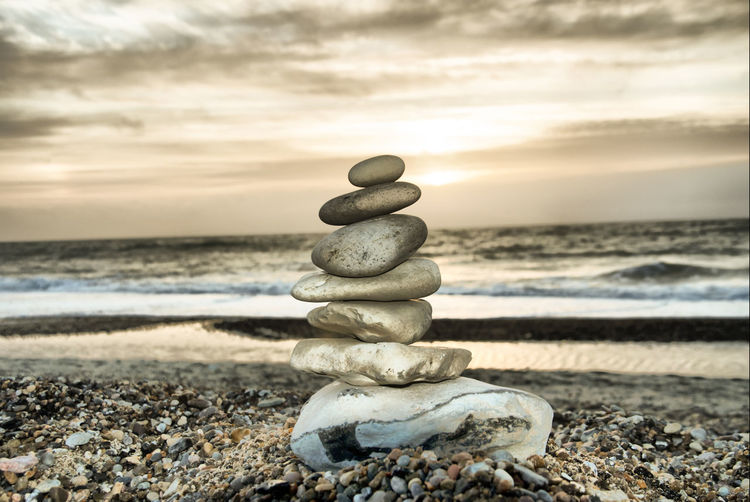 Stone tower on the beach in Denmark Art And Craft Balance Beach Chain Close-up Escapism Getting Away From It All Large Group Of Objects Outdoors Pebble Rock Sand Stack Stone Stone - Object Strength Summer Togetherness Water