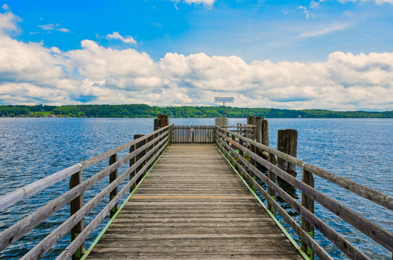 pier at a nice lake with clouds and the blue sky Bavaria Architecture Built Structure Cloud - Sky Day Diminishing Perspective Direction Lake Lake View Long Nature Outdoors Pier Possenhofen Scenics - Nature Sky The Way Forward Tranquil Scene Tranquility Water Wood Wood - Material Wood Paneling