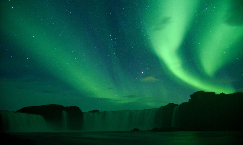 Night Beauty In Nature Scenics - Nature Sky Space Astronomy Star - Space Tranquility No People Tranquil Scene Green Color Nature Water Environment Low Angle View Silhouette Aurora Polaris Non-urban Scene Majestic Iceland Goddafoss Natural Wonder Natural Phenomenon Aurora Borealis Northern Light