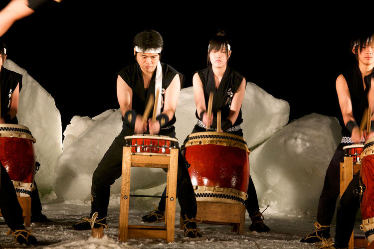 Traditional Japanese drummers (taiko) perform at an outdoor winter festival, Shiretoko, Hokkaido, Japan. Ceremonial Drummers Japan Japanese  Japanese Drumming Blurred Motion Ceremony Ice Festival Night People Real People Shiretoko Taiko Traditional Winter Festival Young Adult Young Women