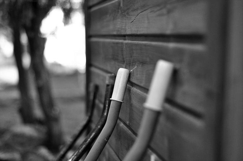 Close-up of  wheelbarrow against wall