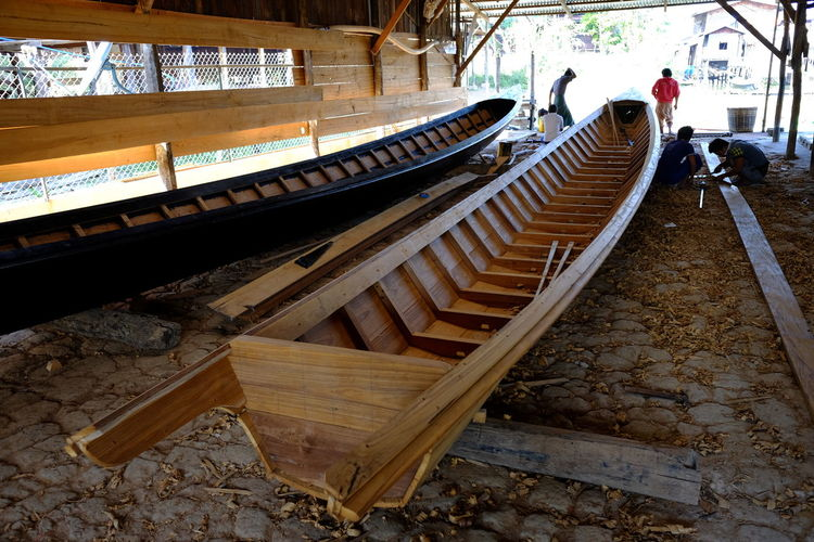 Narrow Boat Production Boat Builders Boat Building Composition Factory Full Frame Indoor Photography Inle Lake Long Boats Manufacturing Mayanmar Mode Of Transport Narrow Boats Nautical Vessels No People Shan State Teak Wood Tourism Tourist Attraction  Tourist Destination Traditional Boats Wood - Material Wood Boat