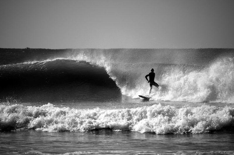 Man Surfing On Sea Wave