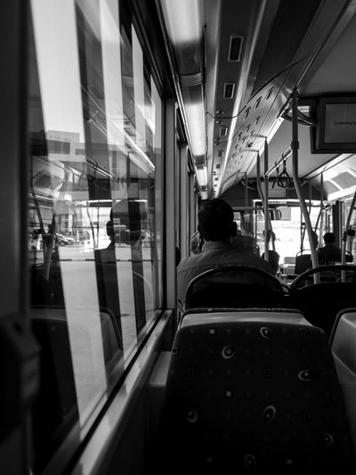 Illuminated Land Vehicle Lifestyles Men Mode Of Transport One Person People Public Transportation Real People Rear View Transportation