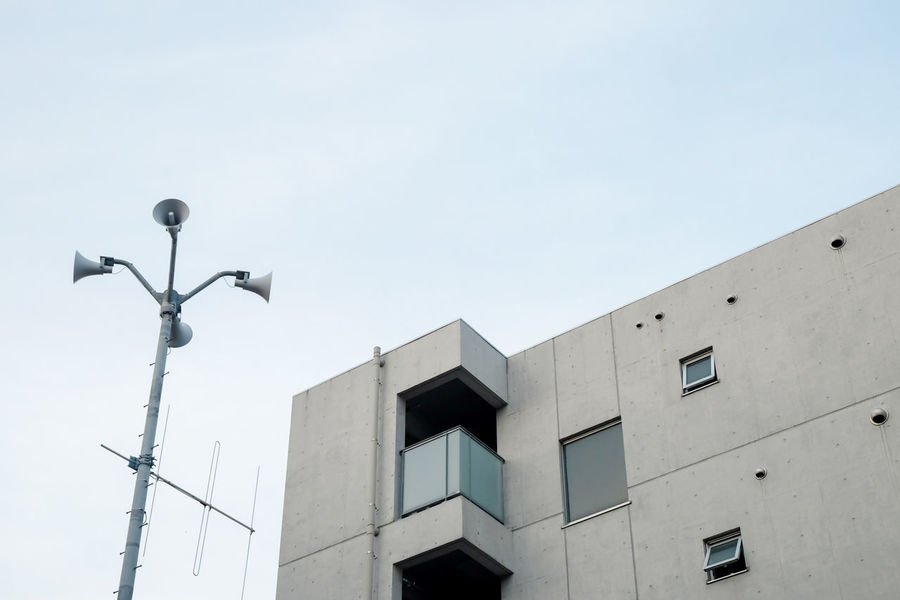 balcony with a nice view and loudspeakers // Architectural Detail Architecture Balcony Building Building Exterior City Clear Sky Concrete Earthquake Exterior Façade Loudspeakers Minimalism Outdoors Protection Shibuya Sky Urban Warning Window