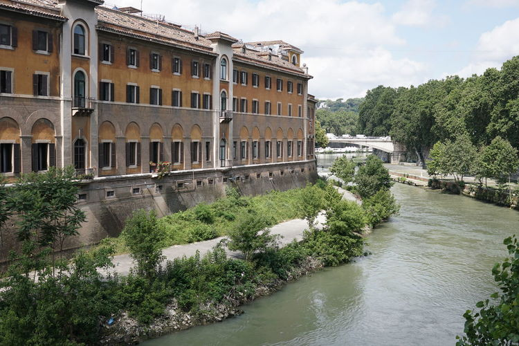 View of the Fatebenefratelli Hospital, a hospital located on the western side of the Tiber Island in Rome Hospital Isola Tiberina Isola Tiberina Rome River View Riverside Tevere River Tiber River Architecture Building Building Exterior Built Structure Fatebenefratelli No People Outdoors River River Tiber Riverbank Riverscape Tevere Tiber Island Tiber Island Rome Tiber River Rome Travel Water Waterfront