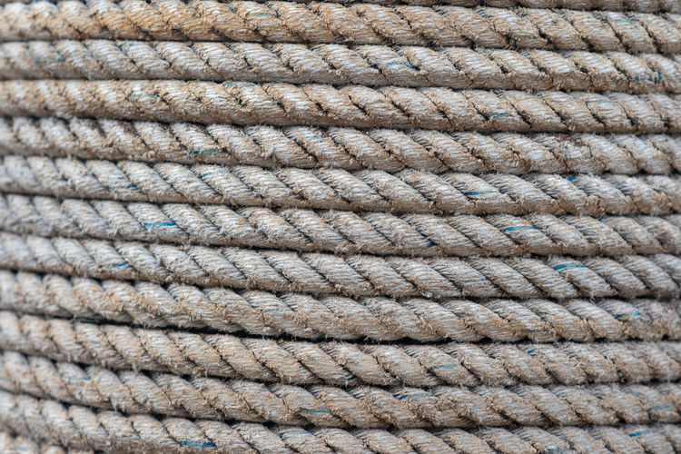 Rope Backgrounds Pattern Full Frame Close-up Textured  No People Strength Rope Extreme Close-up Durability Work Tool Textured Effect Equipment Connection Woven Industrial Equipment Macro Twisted Steel Nautical Equipment Rope