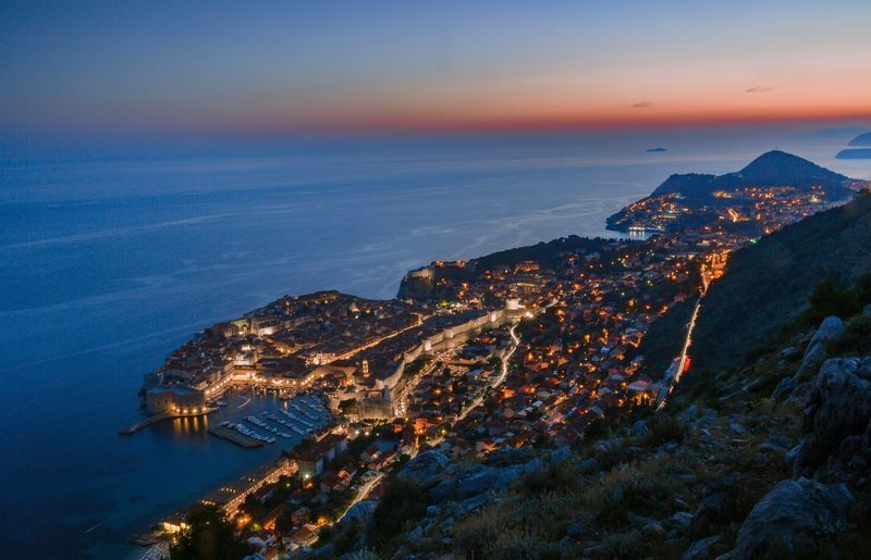 Sunset of old town Dubrovnik Nightshot Night Nightphotography Sea Sea Water Architecture No People High Angle View Beauty In Nature Nature Mountain Built Structure Outdoors Scenics Building Exterior Sunset Tranquility Horizon Over Water Sky Cityscape Day