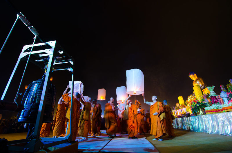 15 may 2014, Magelang, Indonesia : Participants releasing lanterns over the Borobudur temple in Magelang, Central Java during Vesak/Waisak Day celebrations Architecture Arts Culture And Entertainment Belief Built Structure Burning Clear Sky Fire Group Of People Illuminated Lighting Equipment Nature Night Outdoors Performance Real People Religion Sculpture Spirituality