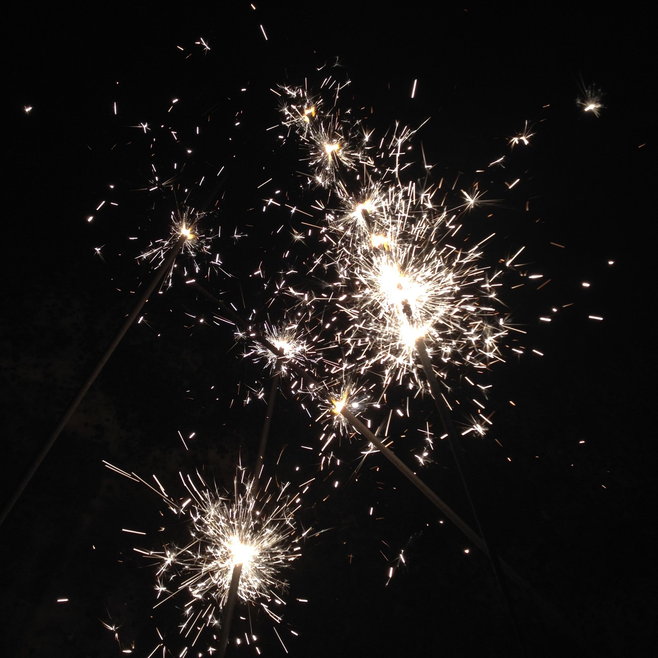 night, firework display, illuminated, celebration, exploding, arts culture and entertainment, long exposure, firework - man made object, event, sparks, low angle view, glowing, motion, firework, entertainment, fire - natural phenomenon, sky, blurred motion, celebration event, smoke - physical structure