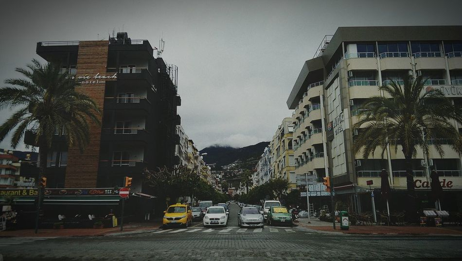 Car Architecture Outdoors Building Exterior Sky Yellow Taxi No People HTC_photography Htc One M7 City Travel Destination Horizon View Mountains And Sky Urban Landscape Onewaystreet Uphill Road Straight Road Straight Up Building Exteriors Eyeem Photography Streetphotography