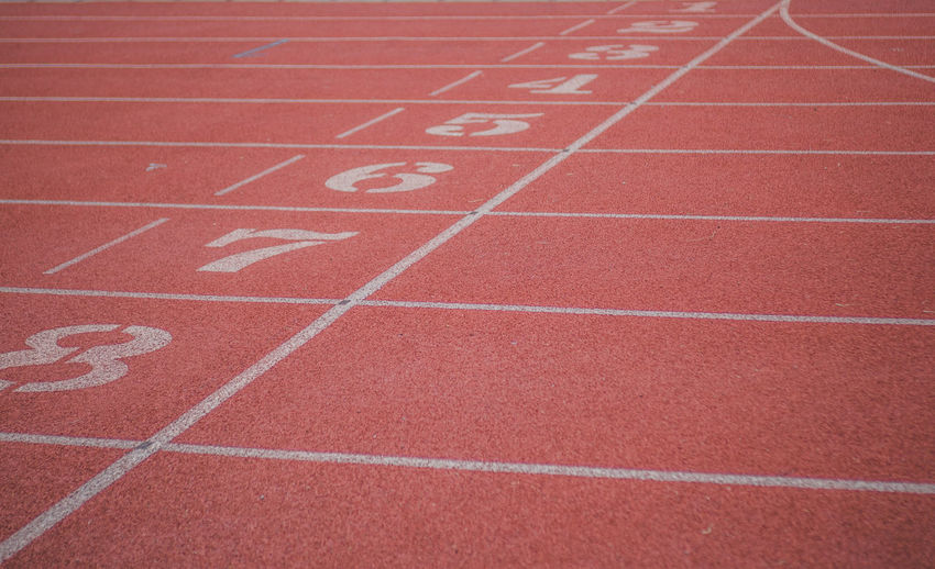 Backgrounds Competition Competitive Sport Curve Day Dividing Line In A Row No People Number Outdoors Playing Field Red Running Track Sport Sports Race Sports Track Stadium Starting Line Track And Field Track Event