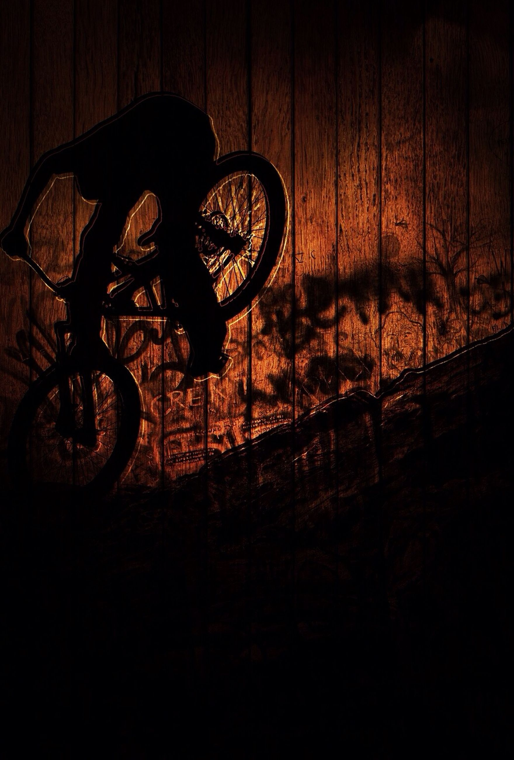 bicycle, silhouette, transportation, land vehicle, mode of transport, shadow, stationary, parking, street, sunlight, parked, outdoors, no people, wall - building feature, sunset, side view, day, leaning, riding