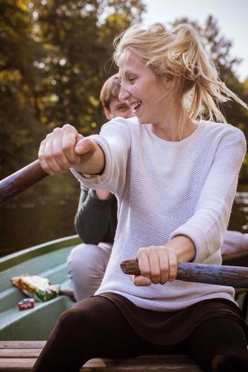 Woman Looking Away While Sitting In Boat