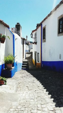 Blue Sunlight Outdoors Sky No People Architecture Architecturephotography Building Photography Travelphotography Portugal Travel Destinations Travelgram Traveltheworld Streetphotography Street Town History Tradition Óbidos  Obidos Portugal
