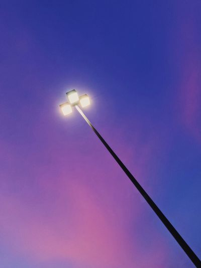 EyeEm Ready   AI Now EyeEm Selects Low Angle View Lighting Equipment Illuminated No People Blue Street Light Floodlight Electricity  Outdoors Sky Minimalobsession Minimalism Minimal Sunset Night