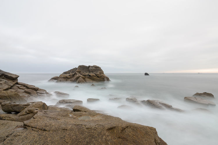 Longexposure of big Rock in the Atlantic Ocean at high tide, France, Brittany, Finistere Rock Rock - Object Solid Sky Beauty In Nature Sea Water Scenics - Nature Rock Formation Nature Tranquil Scene Tranquility Cloud - Sky No People Land Non-urban Scene Day Horizon Over Water Outdoors Stack Rock Eroded Longexposure France Bretagne Bretagnetourisme FinistèreNord Sunrise Tide High Tide Soft Light
