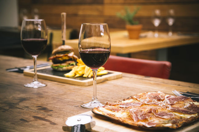 Background Baket Burg Chaise Chips Cuisine Cutlery Cutting Board Dinner Food Ham Italian Food Pizza Pizza Cutter Red Wine Restaurant Rustic Serrano Table Unfocused Wineglass