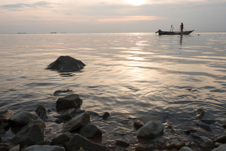 A fisherman over sun set sky at Minyak Beku Beach,Batu Pahat,Johor Batu Pahat Beach Beauty In Nature Cloud - Sky Fisherman Horizon Over Water Johor Outdoors Scenics Sea Sunset Tranquil Scene Tranquility Water The Week On EyeEm