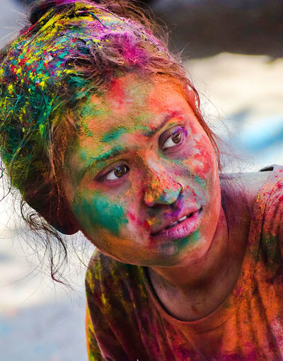 Holi Multi Colored Celebration Happiness Dirty Fun Portrait Looking At Camera Face Paint Human Body Part Traditional Festival Powder Paint Face Powder Smiling Paint Cheerful One Person Ecstatic Adult People