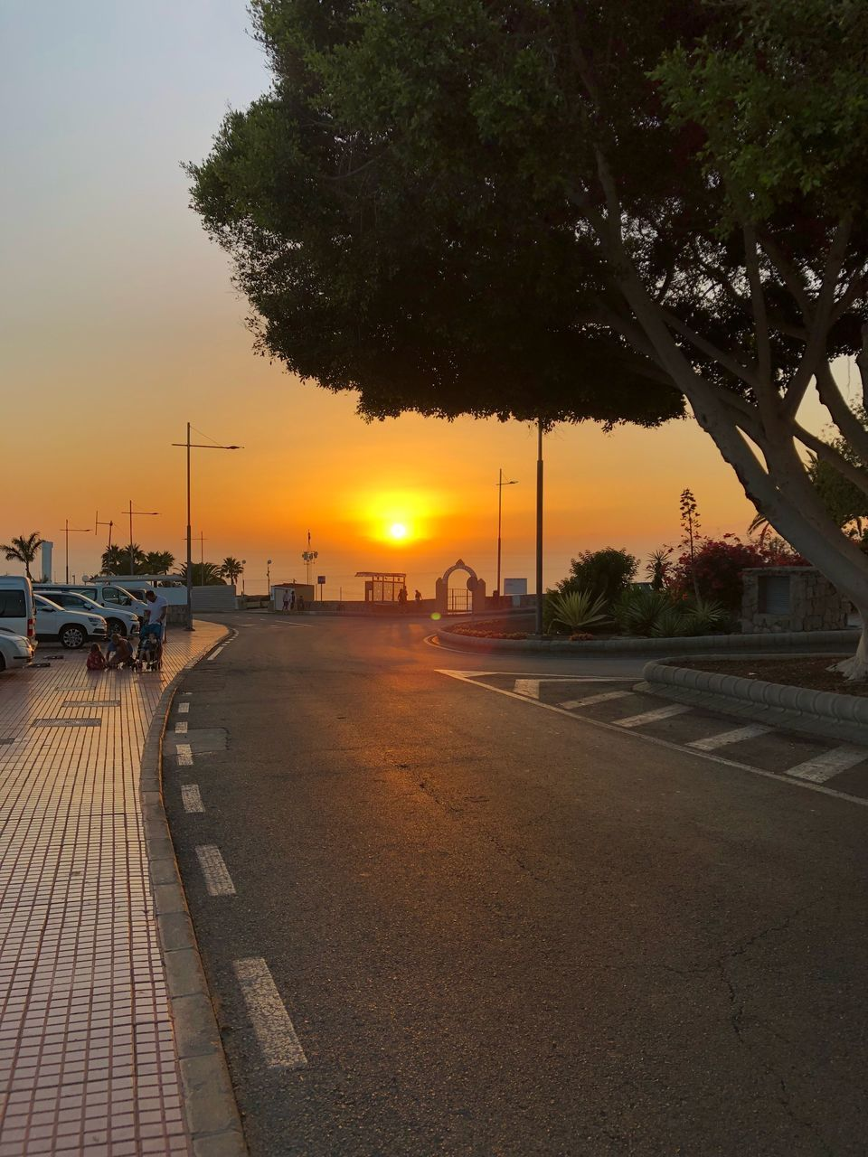 SCENIC VIEW OF STREET AGAINST SKY DURING SUNSET