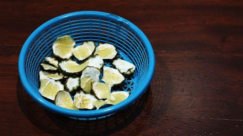 Citrus Hystrix Sliced Wooden Floor Grains On Wood Basket Wicker Basket Mosquito Repellant in Sathorn, Thailand